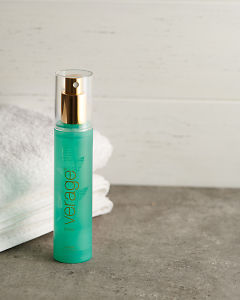 doTERRA Verage Toner with a white towel on a stone bathroom bench top.