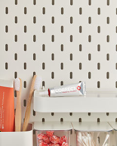 doTERRA Correct-X on a bathroom shelf with additional doTERRA products and bathroom accessories.