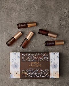 doTERRA Precious Florals Collection featuring Neroli Touch, Jasmine Touch, Rose Touch, Magnolia Touch and Blue Lotus Touch on a gray stone background.