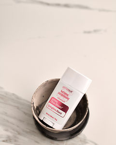 doTERRA Natural Deoderant with Citrus Bloom in a ceramic bowl on a white marble background.