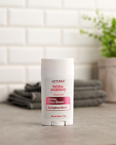 doTERRA Natural Deoderant with Citrus Bloom and bath towels on a grey stone bathroom bench.