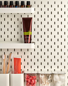 doTERRA Spa Clarifying Mud Mask on a bathroom shelf with bathroom accessories and additional doTERRA products.
