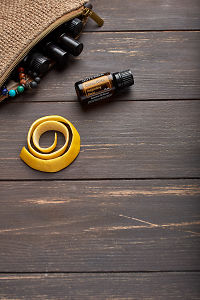 doTERRA Citrus Bliss, lemon peel and clutch with oils on brown wooden background.