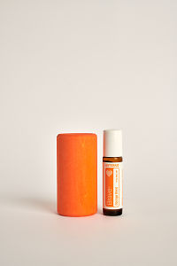 doTERRA Kids Oil Collection roll-on bottle Brave next to an orange wooden block.