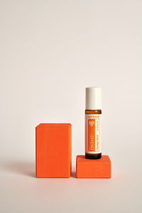 doTERRA Kids Oil Collection roll-on bottle Brave on an orange wooden block.
