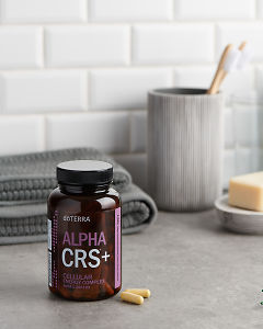 doTERRA Alpha CRS Capsules with bathroom acessories on a bathroom bench top.