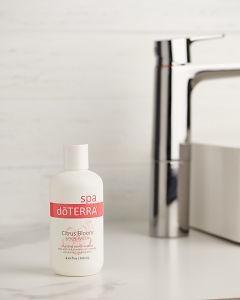doTERRA Citrus Bloom Body Wash on a bathroom vanity.