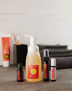 doTERRA On Guard essential oil blend, On Guard Sanitising Mist, On Guard Touch and Stronger with a On Guard Foaming Hand Wash Dispenser on a bathroom bench.
