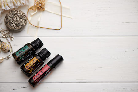 doTERRA Balance, Citrus Bliss and Passion Touch oils and wedding accessories on white rustic wooden background.