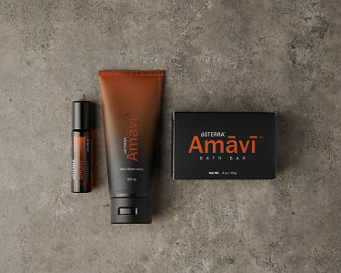 doTERRA Amavi Touch, Amavi After Shave Lotion and Amavi Bath Bar on a gray stone background.