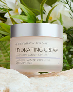 doTERRA Essential Skin Care Hydrating Cream with plats and flowers sitting on a rock.