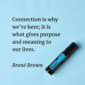 Connection is why we're here; it is what gives purpose and meaning to our lives – inspiration quote about doTERRA Peace Touch printed on a pale blue background.