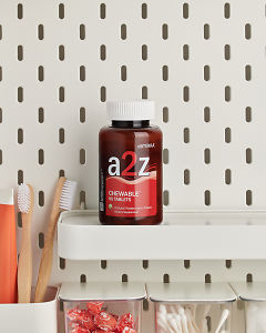 doTERRA a2z Chewable on a bathroom shelf with additional doTERRA products and bathroom accessories.