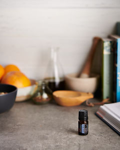 doTERRA Juniper Berry with kitchen equipment on a gray stone kitchen bench.