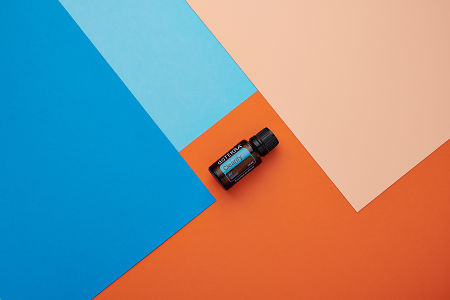 doTERRA DigestZen on a blue and orange geometric background.