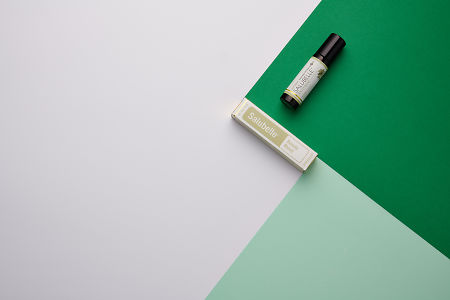 doTERRA Salubelle and product box on dark green, light green and white geometric background.
