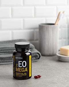 doTERRA xEO Mega softgels with bathroom acessories on a bathroom bench top.