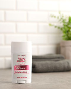 doTERRA Natural Deoderant with Citrus Bloom on a gray stone bathroom bench.