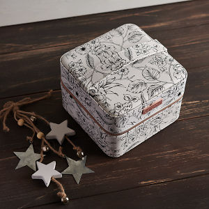 doTERRA Floral Storage Case with holiday decorations on a brown wooden background.