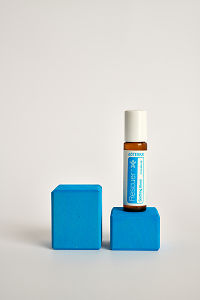 doTERRA Kids Oil Collection roll-on bottle Rescuer on a blue wooden block.