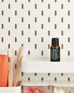 doTERRA Balance Grounding Blend on a bathroom shelf with additional doTERRA products and bathroom accessories.
