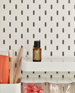 doTERRA Niaouli on a bathroom shelf with additional doTERRA products and bathroom accessories.