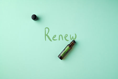 "doTERRA Forgive Touch on a mint colored background with hand written ""Renew""."