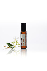 doTERRA Jasmine Touch with jasmine flowers on a white background with reflection.