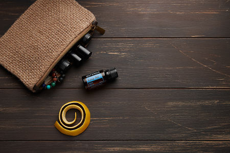 doTERRA Easy Air, lemon peel and clutch with oils on brown wooden background.