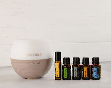 doTERRA CA Winter Protection Kit containing a Petal Diffuser 2.0, Manuka Touch, Rosemary, Copaiba, Litsea and Easy Air on a white background.