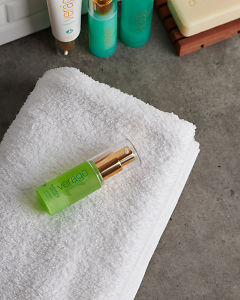 doTERRA Verage Salubelle Hydrating Serum with a white fluffy towel on a stone bathroom bench top.