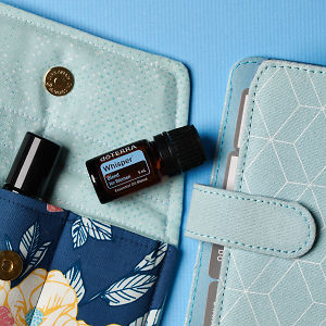 doTERRA Whisper on an essential oil bag with a diary on a blue textured background.