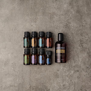 doTERRA AromaTouch Pro Enrolment Kit in a square format on a gray stone background.