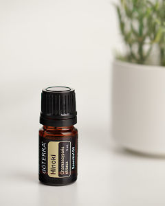 doTERRA Hinoki in close up on a white marble bench.