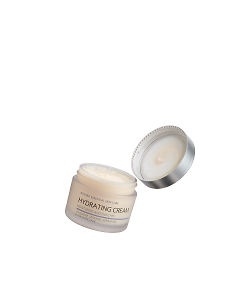 doTERRA Hydrating Cream with the lid off floating on a white background.