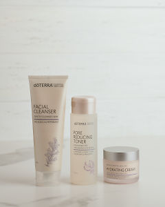 doTERRA Essential Skin Care Facial Cleanser, Pore Reducing Toner and Hydrating Cream on a white background.