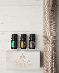 doTERRA Yoga Collection of Align, Arise and Anchor  with a yoga mat on a white wooden background.