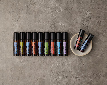 doTERRA Touch Enrolment Kit with a flexible layout on a gray stone background.