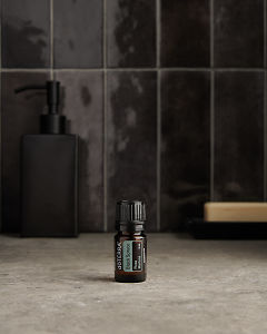 doTERRA Black Spruce on a bathroom benchtop.