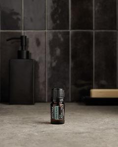 doTERRA Black Spruce on a bathroom benchtop.