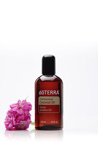 doTERRA Fractionated Coconut Oil with a flower on a white background with reflection.