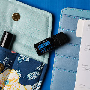 doTERRA Blue Tansy on an essential oil bag with a diary on a blue textured background.