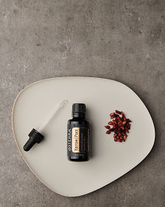 doTERRA Yarrow|Pom with pomegranate seeds on a white plate on a gray stone background.