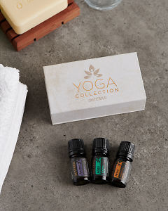 doTERRA Yoga Collection on a gray stone bathroom bench top.