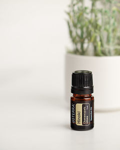 doTERRA Hinoki on a white marble bench.