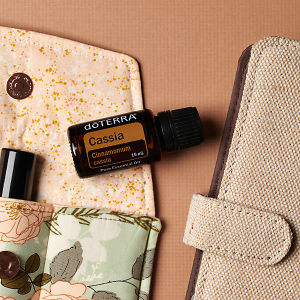 doTERRA Cassia on an essential oil bag with a diary on a brown textured background.