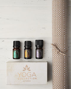 doTERRA Yoga Collection of Affirm, Ascend and Anchor  with a yoga mat on a white wooden background.