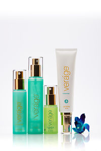 doTERRA Verage Skin Care Collection with a blue orchid on a white background with reflection.