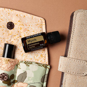 doTERRA Myrrh on an essential oil bag with a diary on a brown textured background.
