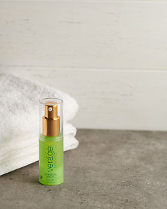 doTERRA Verage Salubelle Hydrating Serum with a white towel on a stone bathroom bench top.